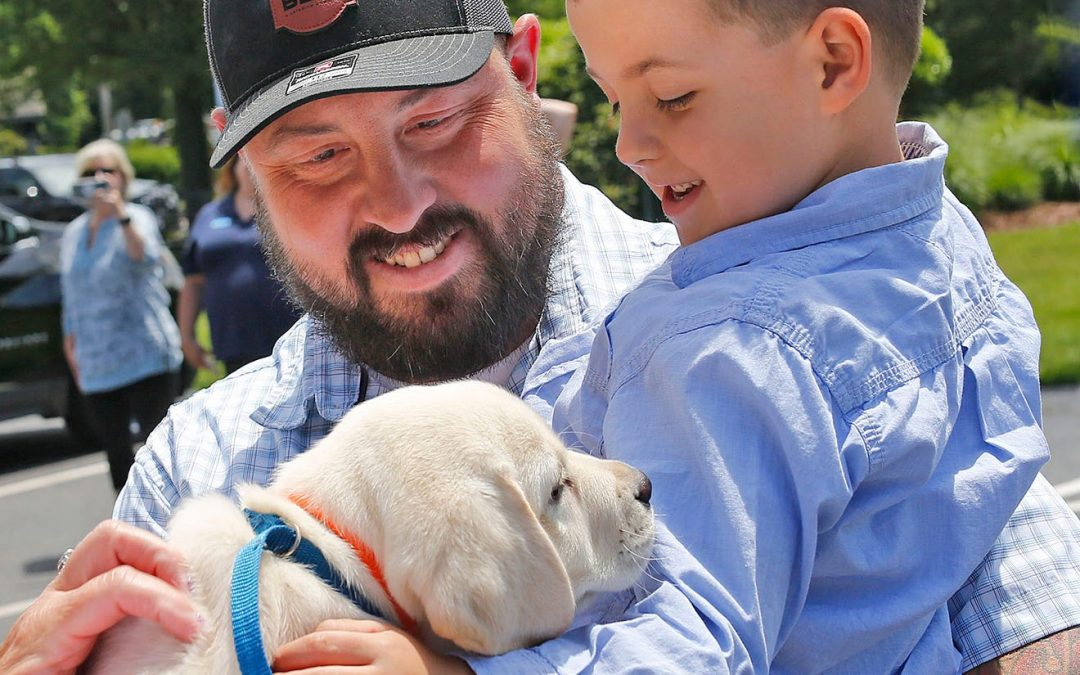 Marshfield family gifted new puppy after losing dog in house fire
